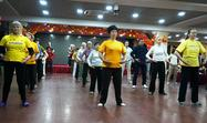 Practitioners do the Falun Dafa exercises as a group before the conference begins