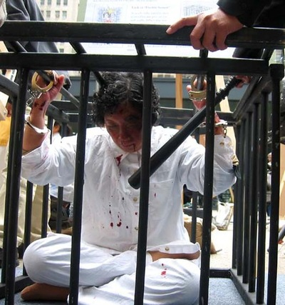 Torture reenactment: Locked in a metal cage.