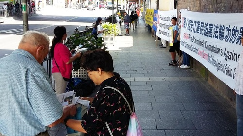People gather to learn about the persecution of Falun Gong in China.