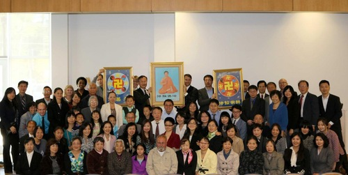 A group of attendees pose for a photo after the conference.