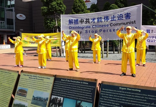 Falun Gong practitioners demonstrating the exercises
