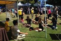Learning the Falun Dafa exercises at San Diego Earth Day event in Balboa Park