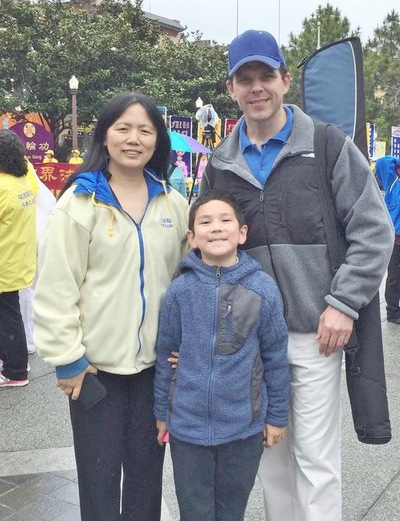 Ms. Wang Feng and her family took part in the Dafa Day celebration. Ms. Wang said that she found the meaning of life in Falun Gong.