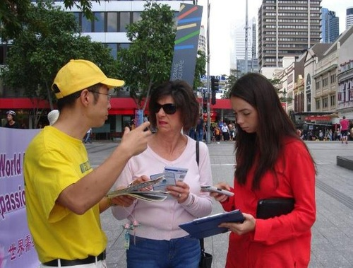 Talking to people about Falun Gong.