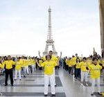 Group exercises in front of the Eiffel Tower on May 8, 2016