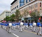 The Divine Land Marching Band led the Falun Gong group in the parade.