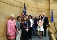 Minnesota Senators Alice Johnson (first from left) and Dan Hall (first from right) take a group photo with Falun Gong practitioners.