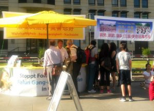 Falun Gong practitioners tell people about Falun Gong and the persecution in China on June 11, 2016.
