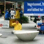 Demonstrating the Falun Gong exercises in downtown, Perth, Australia, on June 11.