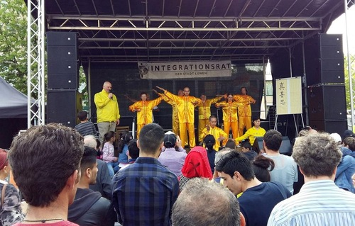 Falun Gong practitioners demonstrate the exercises on-stage.