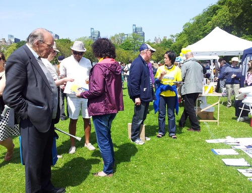 An Italian gentleman (with the stick) learned Falun Gong many years ago, but stopped for various reasons. He was glad to run into practitioners today so that he could resume practicing.