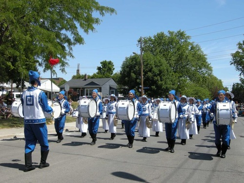 The Falun Dafa Divine Land Marching Band in the Sound of Music Festival Parade in Burlington.