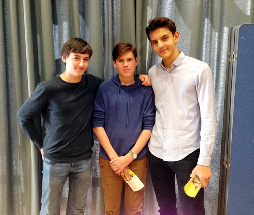 Felix Walker (right), Martin Quick (left) and their friend Oliver at the Falun Gong presentation at their school.