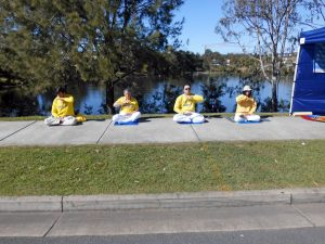 Falun Dafa Practitioners demonstrating the meditation exercise.