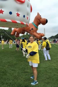 Sue McInturf helps out to show her support for Falun Gong.