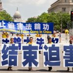 "Five practitioners hold large Chinese characters reading ""Falun Dafa is Good."""
