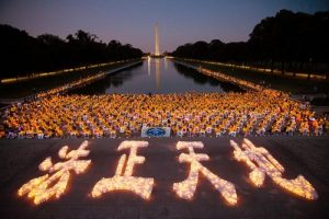 Falun Gong practitioners hold a candlelight vigil in front of Lincoln Memorial on the evening of July 14, 2016.