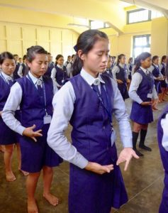 High school girls at a Catholic school in the northeast of India learn the Falun Dafa exercises.