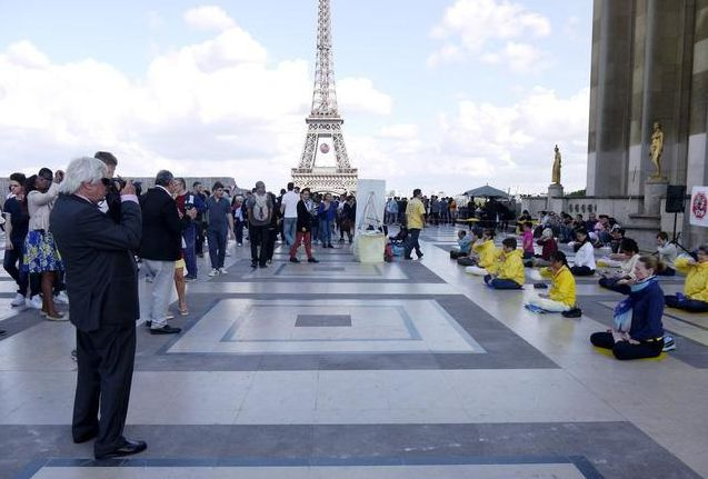 Demonstrating the Falun Gong exercises near the Eiffel Tower