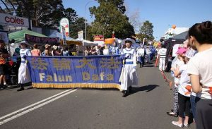 "Falun Dafa practitioners attended the parade at the ""Spring into Corrimal"" Family Festival."