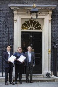 Dr. Alex Chen of DAFOH (left), and Dr. Liu and Helen, representatives of UK Falun Dafa Association, submit petition.