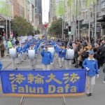 Tian Guo Marching Band leads the march