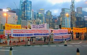 Falun Gong practitioners hold a protest outside the conference venue.
