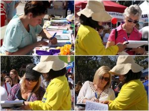 "Passersby sign petitions at the Falun Dafa stall at the ""Spring into Corrimal"" Family Festival on September 11, 2016."