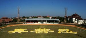"Forming the Chinese characters for ""Truthfulness-Compassion-Forbearance"" at Ngurah Rai Stadium, Denpasar, Indonesia."