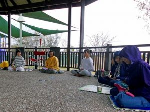 Falun Dafa practitioners exercising the sitting meditation.