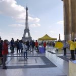 Practitioners demonstrate the Falun Gong exercises on Human Rights Square in Paris, France.