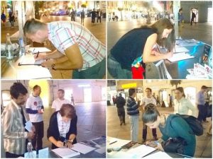 Signing the petition to condemn the persecution in downtown Rijeka, Croatia.