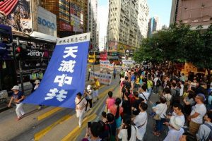 Banners call on the Chinese to quit the Communist Party so as to stand up against its atrocities.