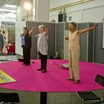 Practitioners demonstrate the exercises.