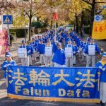 Falun Gong practitioners conduct activities including performance by the Tian Guo Marching Band in front of the Chinese Consulate in Munich.