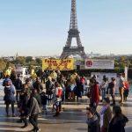 Falun Dafa community even near the Eiffell Tower in Paris, Falun Dafa practitioners sharing and providing information on the persecution of Falun Dafa in China.