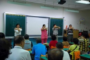 Learning the Falun Dafa exercises.