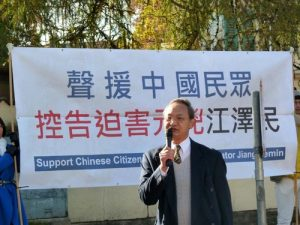 Democracy advocate Liangyiong Fei speaks at the rally.