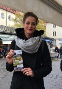 Munich resident Simone showing the flyer she read.
