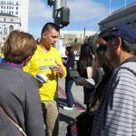 Dorian Fillip talks to tourists in San Francisco about Falun Gong.