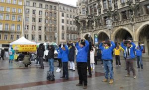 Group exercises at Marienplatz in Munich, German.