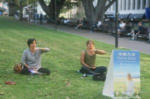 Manuela from Argentina (right) learns the Falun Gong exercises.