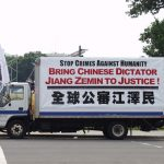 "A Truck Covered in Large Posters About ""Bringing Jiang to Justice"" Slowly Travels the Streets of the Washington DC, USA."