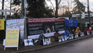 Practitioners protest in front of the Chinese Embassy in Helsinki, Finland.