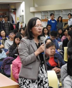 Associate Professor Liao Huiwen (holding the microphone) said China's organ pillaging reminds her of the Holocaust.
