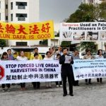 Falun Gong practitioners rally near the Chinese Embassy in Malaysia and condemn the persecution in China.