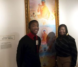 Mrs. Clark and her son in front of their favorite painting.