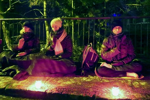 Falun Gong Practitioners quietly meditating in front of the Chinese Embassy in Bratislava, Slovakia to continue to raise awareness of the brutal persecution of Falun Gong in China.