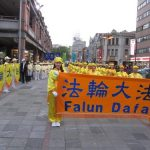 Falun Gong practitioners perform in the parade.