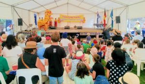 Falun Gong practitioners perform on the stage.